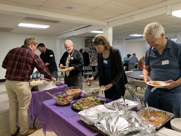 April 2019 WHCA meeting attendees in a food buffet line.