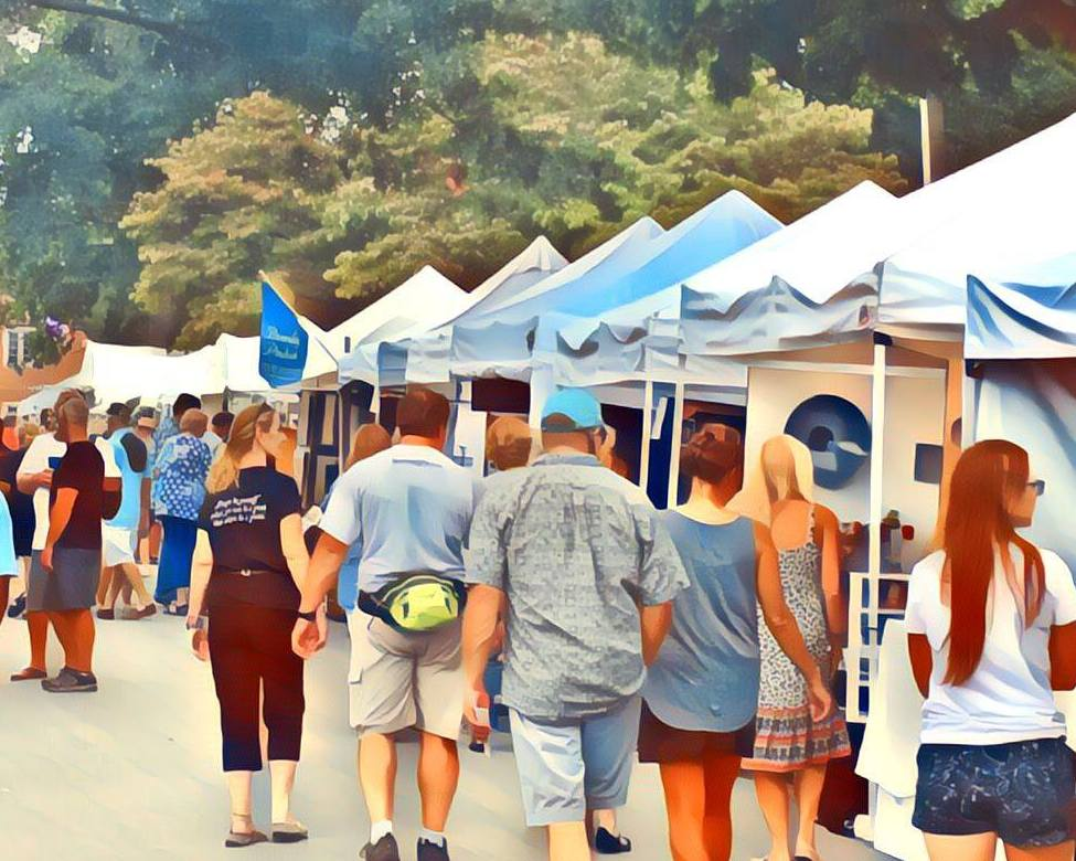Image of guests walking through artists' tents at festival.